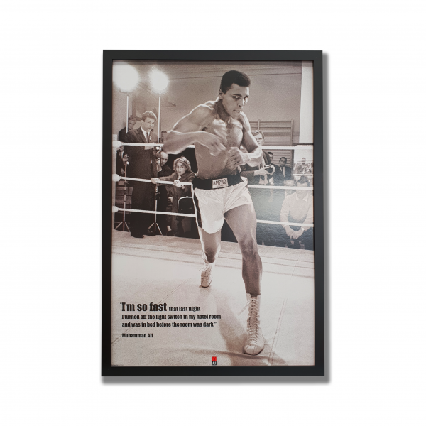 Black and white photo of Muhammad Ali with inpiring quote in black frame