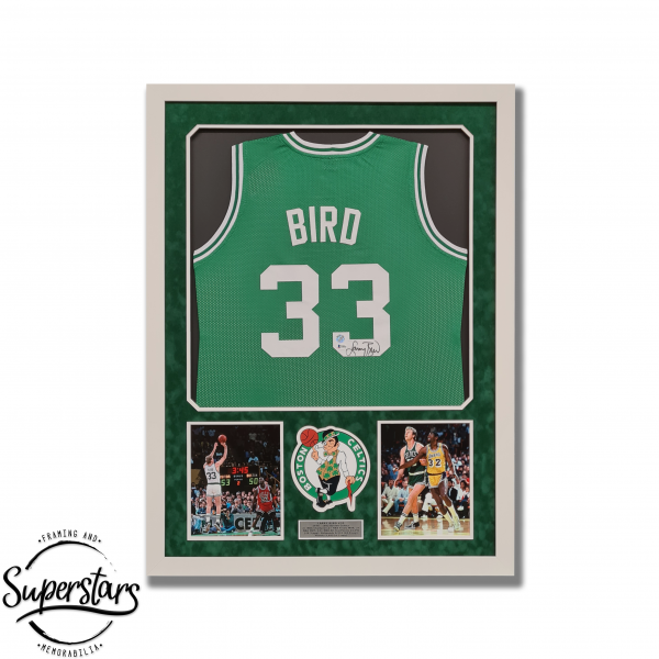 A Boston Celtics jersey signed my Larry Bird, with action photography in a custom frame.