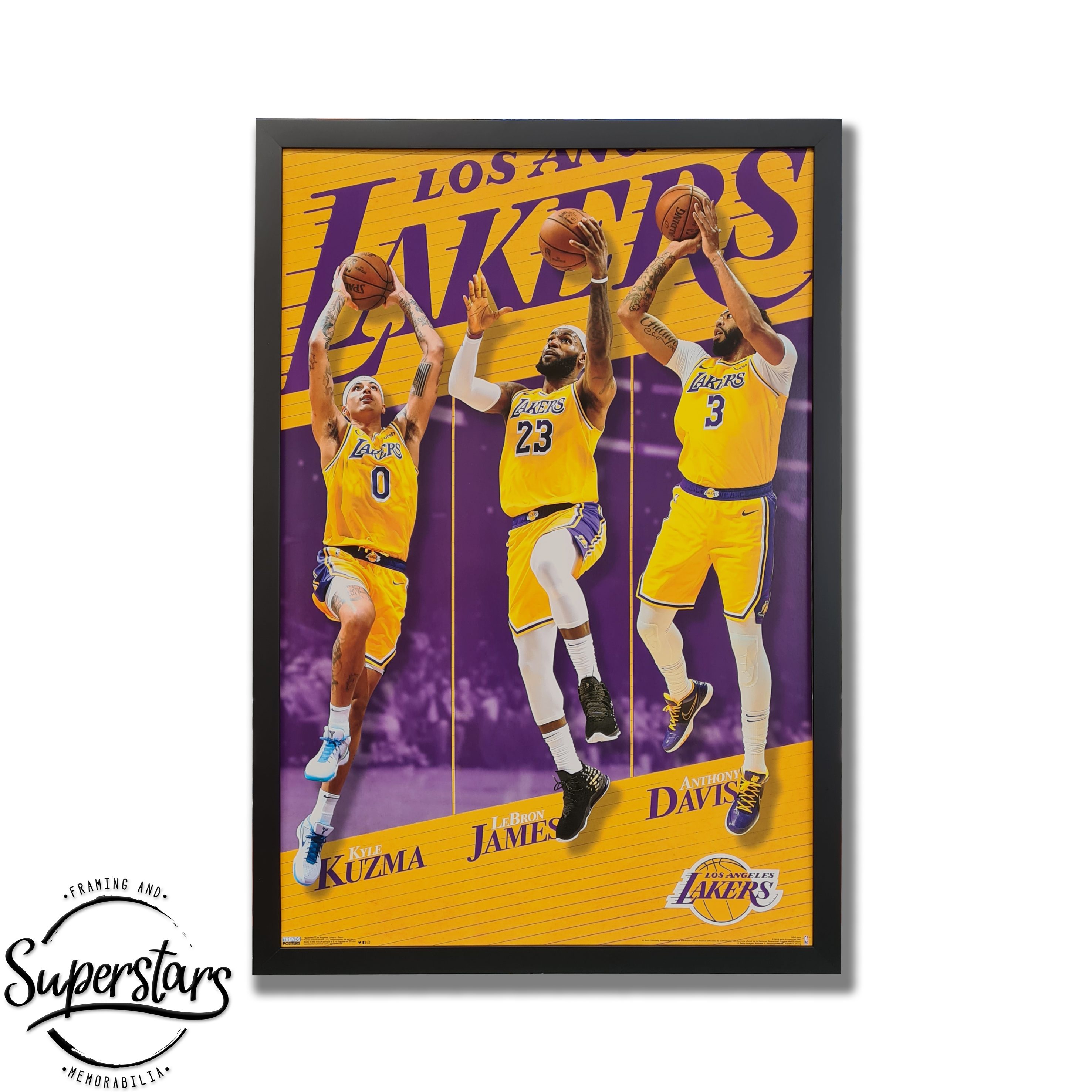 A poster with photos of Lebron James, Kyle Kuzma and Anthony Davis from the LA Lakers.